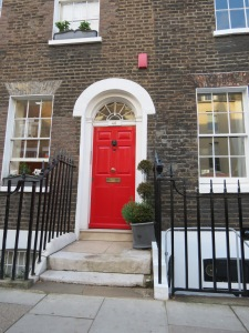 Nothing more is necessary to compliment the beautiful simplicity of this Chelsea Georgian house than a red door.